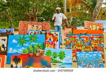 Las Terrenas, Dominican Republic - May 22, 2011: Haitian art seller on the beach