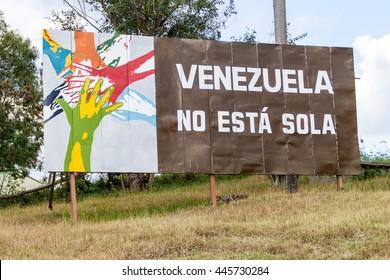 LAS TUNAS, CUBA - JAN 27, 2016: Propaganda billboard at Plaza de la Revolucion (Square of the Revolution) in Las Tunas. It says: Venezuela is not alone.
