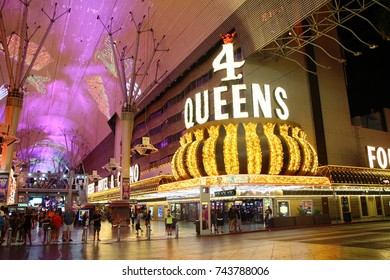 LAS VEGAS, NEVADA—AUGUST 2015: Colorful lights at Freemont in Las Vegas at night, with tourists and locals milling around.