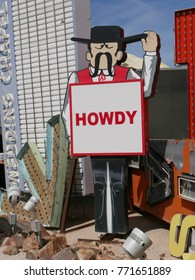 "LAS VEGAS, NEVADA—APRIL 2017:  An old billboard with ""Howdy"" at the Neon Museum or neon boneyard in Las Vegas, Nevada."