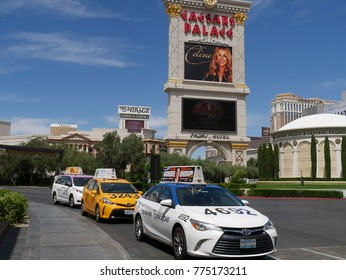 LAS VEGAS, NEVADA—APRIL 2017:  Taxis wait in line outside big hotels and casinos for passengers at the Strip in Las Vegas, Nevada.