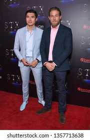 """LAS VEGAS - APR 02:  Henry Golding and Charlie Hunnam arrives for the CinemaCon 2019 - STXfilms presentation """"The State of the Industry: Past, Present and Future' on April 02, 2019 in Las Vegas, NV"""