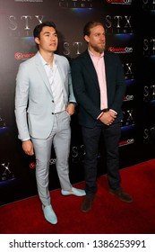 LAS VEGAS - APR 2:  Henry Golding, Charlie Hunnam at the 2019 CinemaCon - STX films at Caesars Palace on April 2, 2019 in Las Vegas, NV