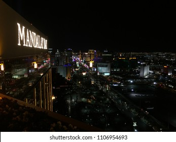LAS VEGAS - APRIL 10, 2018: View of Las Vegas and strip from aerial pov upward looking down from Mandalay Bay rooftop bar.