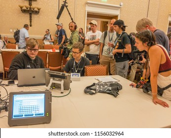 LAS VEGAS - AUGUST 10, 2018: Security researchers at DEFCON hacking conference are working to identify hardware and software vulnerabilities in the voting machines currently in use in the US.