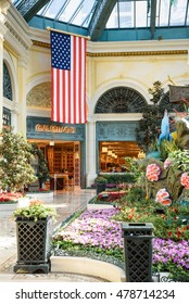 LAS VEGAS - AUGUST 16: The Bellagio Hotel & Casino on August 16, 2016 in Las Vegas. This is the Cafe Bellagio inside the hotel with american flag hanging outside.
