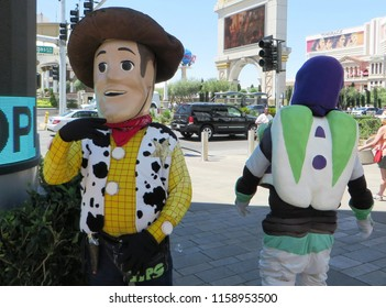 Las Vegas, August 2018 - People dressed like Woody and Buzz Lightyear, famous characters from Toy Story, famous computer-animated buddy comedy adventure film. Located on the Las Vegas Strip, Nevada.