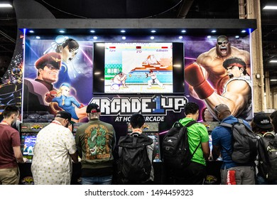 LAS VEGAS - AUGUST 3, 2019: Attendees playing Street Fighter II on Arcade 1UP retro cabinet machines at eSports tournament EVO 2019 Evolution Championship Series at Mandalay Bay Events Center.