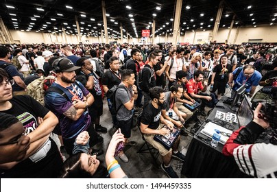 LAS VEGAS - AUGUST 3, 2019: Wide-angle view of videogame competitors playing Street Fighter V (SFV) at eSports fighting game tournament EVO 2019 Evolution Championship Series.