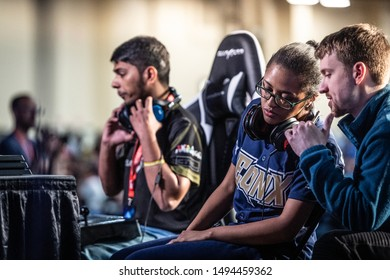 """LAS VEGAS - AUGUST 3, 2019: Tekken 7 player Jeannail """"Cuddle_Core"""" Carter from EQNX Gaming receiving coaching advice at eSports fighting game tournament EVO 2019 Evolution Championship Series."""