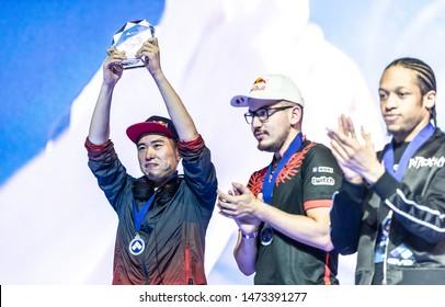 LAS VEGAS - AUGUST 4, 2019: Street Fighter V (SFV) champion Masato Bonchan Takahashi from Team Red Bull raising trophy at eSports tournament EVO 2019 Evolution Championship Series.
