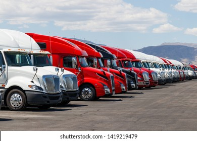 Las Vegas - Circa June 2019: International and Volvo Semi Tractor Trailer Trucks Lined up for Sale. International is owned by Navistar VII