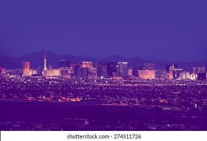 Las Vegas Cityscape at Night in Vintage Purple Color Grading. Las Vegas, Nevada, United States.
