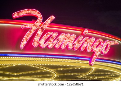LAS VEGAS - DEC 13 : The Flamingo hotel and casino sign on December 13, 2012 in Las Vegas. Las Vegas in 2012 is projected to break the all-time visitor volume record of 39-plus million visitors