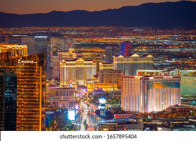 LAS VEGAS - DEC 26, 2015: Luxury hotels including Wynn, Encore, Caesars Palace, Treasure Island at night from top of the Stratosphere Tower in Las Vegas, Nevada, USA.
