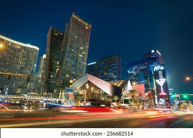 LAS VEGAS - DECEMBER 7, 2013: blurred lights on the Strip at sunset. Aria Resort and Casino is a luxury accommodation building, part of City Center complex on the Las Vegas Boulevard in Nevada Usa