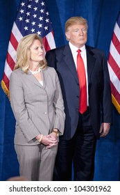 LAS VEGAS - FEB 2: Donald Trump (R) and Ann Romney watch as Mitt Romney speaks at the Trump Hotel on February 2, 2012 in Las Vegas, Nevada. Trump is endorsing Romney for president.