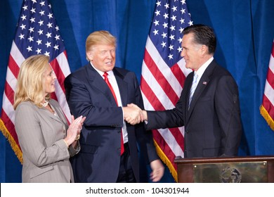 LAS VEGAS - FEB 2: Mitt Romney (C) shakes hands with Donald Trump as Romney's wife, Ann Romney, watches at the Trump Hotel on February 2, 2012 in Las Vegas, Nevada. Trump is endorsing Romney for president.