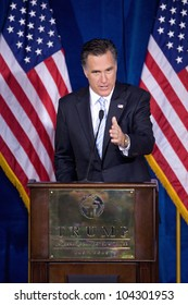 LAS VEGAS - FEB 2: Mitt Romney gestures as he speaks at the Trump hotel on February 2, 2012 in Las Vegas, Nevada. Donald Trump is endorsing Romney for president.