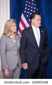 LAS VEGAS - FEB 2: Mitt Romney and his wife, Ann Romney, listen as Donald Trump (off camera) endorses him for president at the Trump Hotel on February 2, 2012 in Las Vegas, Nevada.