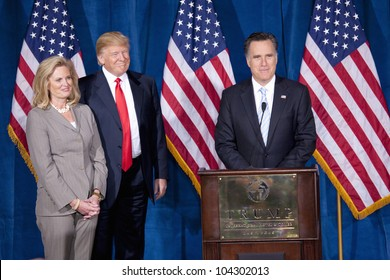 LAS VEGAS - FEB 2: Mitt Romney (R) speaks as Donald Trump and Romney's wife, Ann Romney, watch at the Trump Hotel on February 2, 2012 in Las Vegas, Nevada. Trump is endorsing Romney for president.
