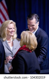 LAS VEGAS - FEB 2: Mitt and Ann Romney hug an unidentified person at the Trump hotel on February 2, 2012 in Las Vegas, Nevada. Donald Trump has endorsed Romney for president.