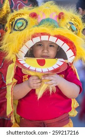 LAS VEGAS - FEB 21 : A young participant at the Chinese New Year parade held in Las Vegas , Nevada on February 21 2015