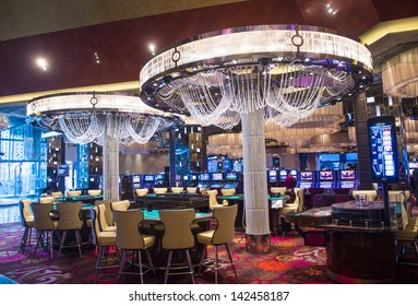 LAS VEGAS - FEB 26 : The casino of Cosmopolitan hotel on February 26 2013 in Las Vegas. The Cosmopolitan opened in 2010 and it has 2,995 rooms and 75,000 sq ft casino.