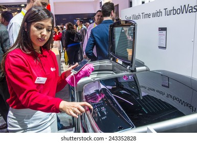 LAS VEGAS - JAN 09 : A smartphone uses to control a LG front loading washing machine at the CES show held in Las Vegas on January 09 2015 , CES is the world's leading consumer-electronics show.