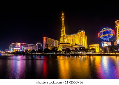 LAS VEGAS - JANUARY 24, 2018 : Fountains of Bellagio with bright lights of hotels on Las Vegas Strip in Paradise, Nevada.