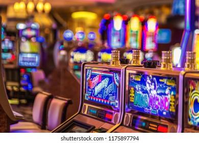 LAS VEGAS - JANUARY 24, 2018 : The Venetian Resort Hotel & Casino slot machines and gamblers. located in Nevada, USA.