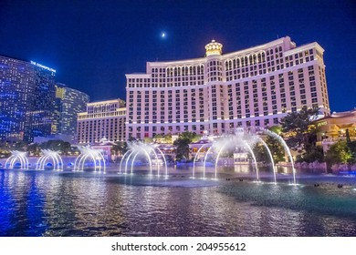 LAS VEGAS - JULY 03 : Bellagio hotel and the dancing fountains in Las Vegas on July 03 2014. Bellagio is a luxury hotel and casino located on the Las Vegas Strip. The Bellagio opened on 1998.