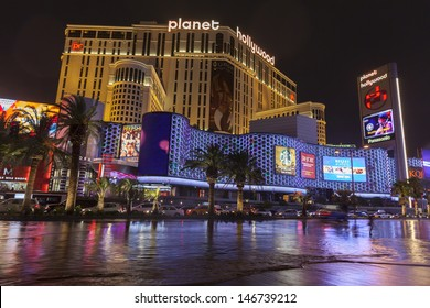 LAS VEGAS - JULY 19, - Vegas Strip on July 19, 2013 in Las Vegas. The lights from Planet Hollywood reflect in flood water that covers the strip.