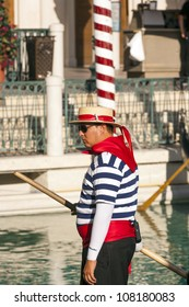 LAS VEGAS - JUNE 15: Gondolier at The Venetian Resort Hotel & Casino on June 15, 2012. The resort opened on May 3, 1999 with flutter of white doves,  singing gondoliers and actress Sophia Loren.