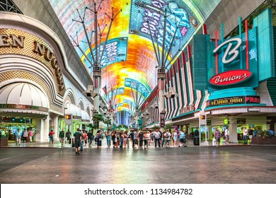 LAS VEGAS - JUNE 16, 2012 : people at Fremont Street in Las Vegas. The street is the second most famous street in the Las Vegas. Fremont Street dates back to 1905, when Las Vegas was founded.