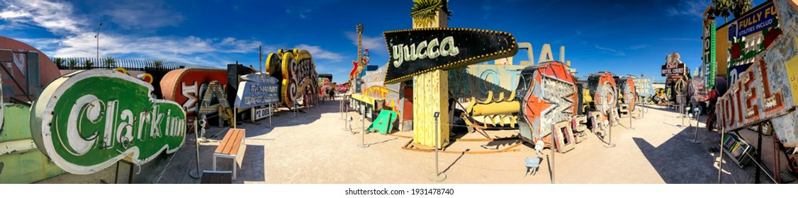 LAS VEGAS - JUNE 27, 2019: The Neon Museum, collection of neon old signs on a beautiful sunny day. Panoramic view.