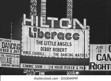 LAS VEGAS – JUNE22, 1979: Hilton Hotel and Liberace show logo in Las Vegas Boulevard. Vintage picture taken in 1979.