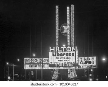 LAS VEGAS – JUNE22, 1979: Hilton Hotel logo in Las Vegas Boulevard. Vintage picture taken in 1979.