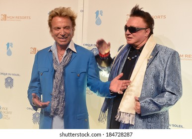 LAS VEGAS - MARCH 21: Former magicians Siegfried (L) and Roy arrives at Cirque du Soleil's annual 'One Night for One Drop' at the Mandalay Bay Resort and Casino on March 21, 2014 in Las Vegas, Nevada