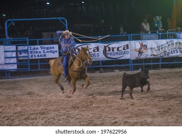LAS VEGAS - MAY 16 : Cowboys Participating in a Calf roping Competition at the Helldorado days Rodeo , A Professional Rodeo held in Las Vegas, Nevada on May 16 2014