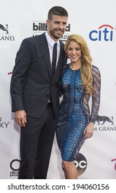 LAS VEGAS - MAY 18 : Soccer player Gerard Pique (L) and recording artist Shakira attends the 2014 Billboard Music Awards at the MGM Grand Garden Arena on May 18 , 2014 in Las Vegas.