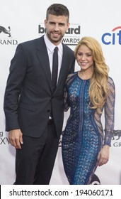 LAS VEGAS - MAY 18 : Soccer player Gerard Pique (L) and recording artist Shakira attend the 2014 Billboard Music Awards at the MGM Grand Garden Arena on May 18 , 2014 in Las Vegas.