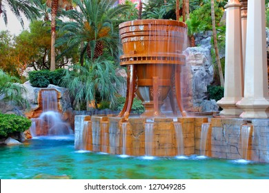 LAS VEGAS - MAY 23: The Mandalay Bay Resort and Casino on May 23, 2012 in Las Vegas.  Mandalay Bay opened in 1999 and seen here is a fountain and pool near the entrance to the resort.