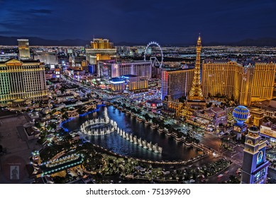 Las Vegas Nevada 2017-08-15: a panoramic view of the Las Vegas Strip, as seen from a balcony, in the Cosmopolitan Hotel, at night.