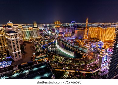 Las Vegas Nevada 2017-09-16: a panoramic view of the Las Vegas Strip, as seen from a balcony, in the Cosmopolitan Hotel, at night.