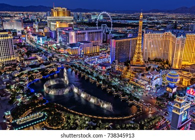 Las Vegas Nevada 2017-10-13: a panoramic view of the Las Vegas Strip, as seen from a balcony, in the Cosmopolitan Hotel, at night.