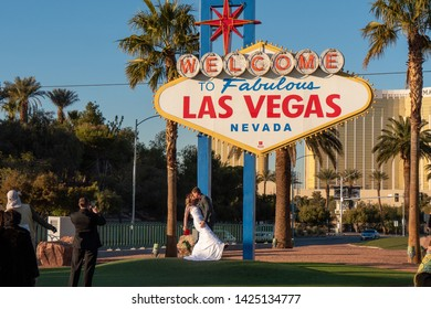 LAS VEGAS, NEVADA. 20th May, 2019: Couple at the famous Las Vegas sign at city entrance