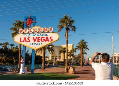 LAS VEGAS, NEVADA. 20th May, 2019: A man take a picture of a bride at the famous Las Vegas sign at city entrance