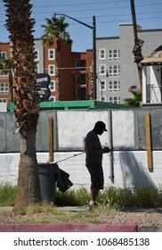 Las Vegas, Nevada, April 8, 2018: Silhouette of a man using smartphone in urban surroundings