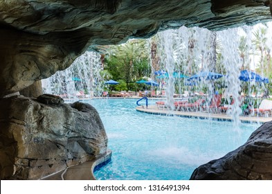 Las Vegas, Nevada - August 4, 2018: Outdoor tropical pool area at the JW Marriott hotel and resort, with a waterfall pool, shown from behind the falls